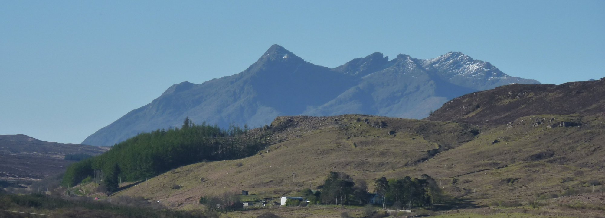 First good sight of the Cuillins, from the Braes road - Sgurr nan Gillean is the pointy one on the left