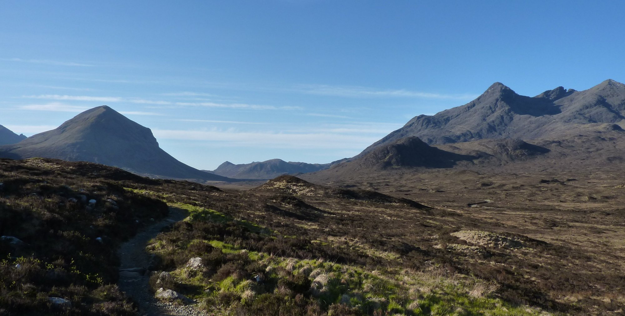 It's a beautiful warm, early morning, heading into the glen with Marsco to the left and the Cuillins to the right