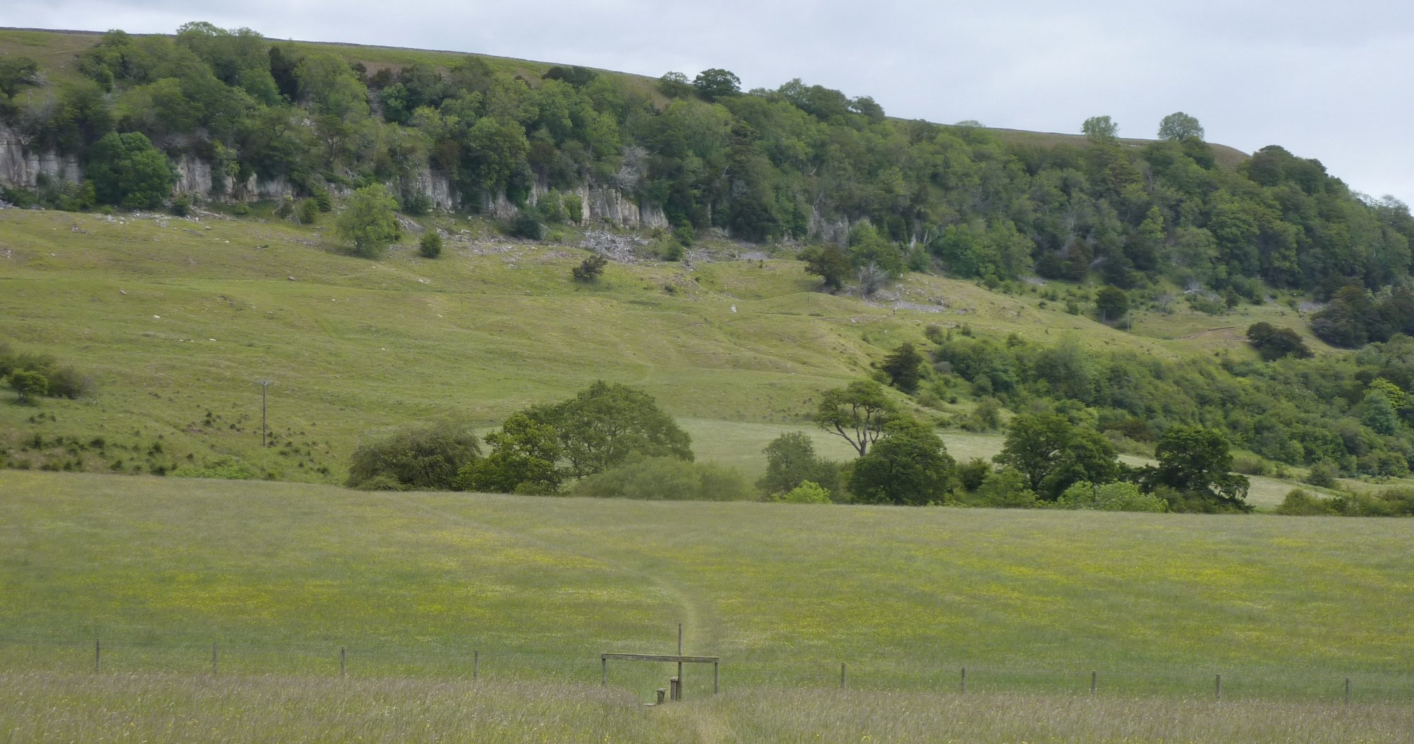 Looking back across the fields to Applegarth Scar