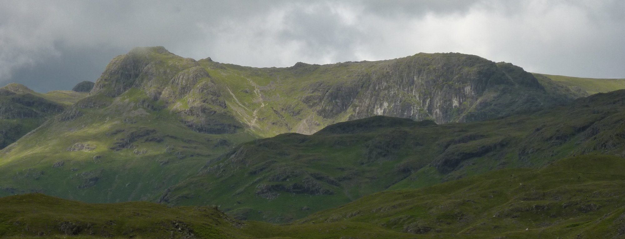 Langdale Pikes in the distance, across the lumpy stuff