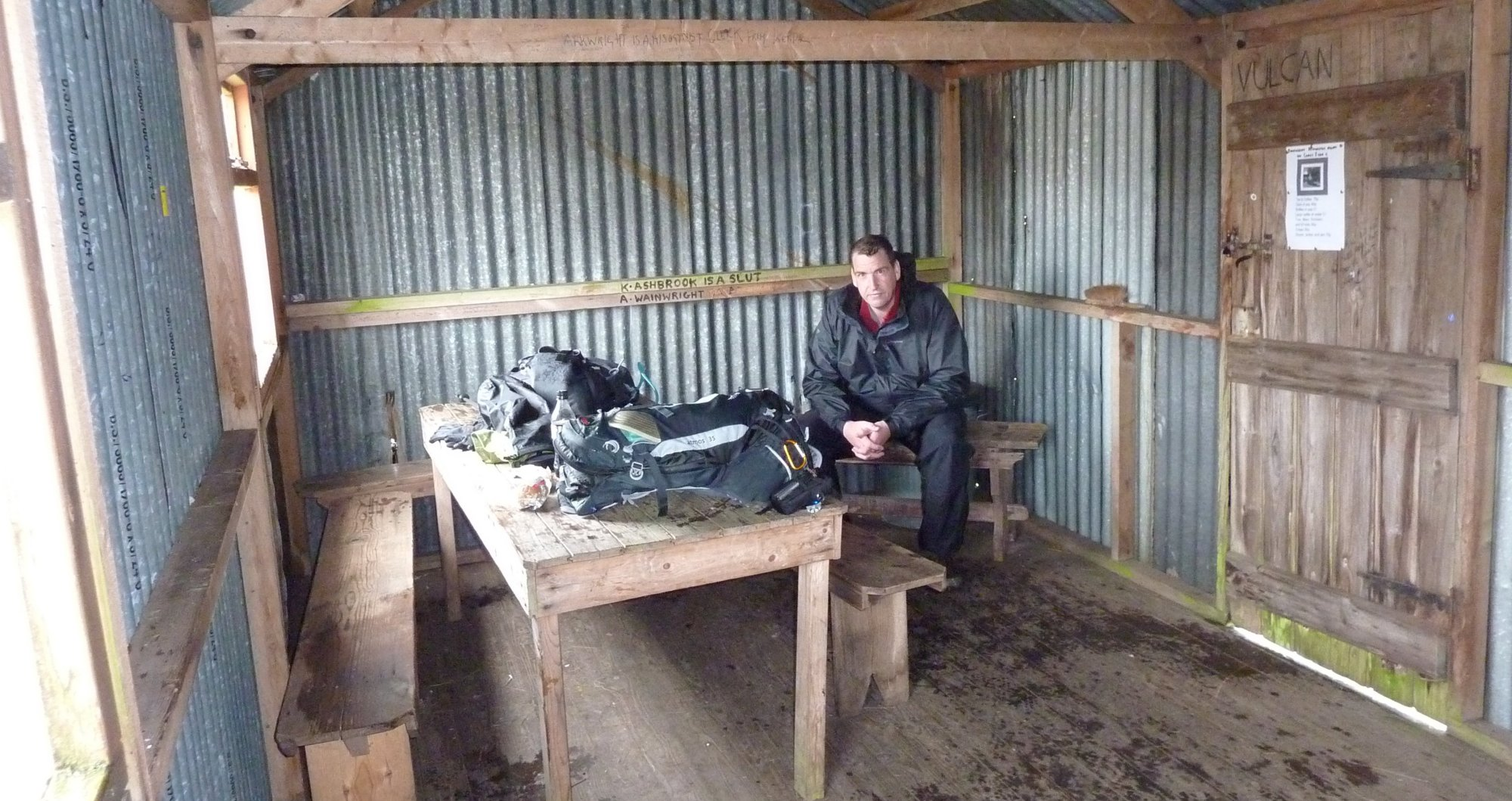 Taking refuge in the shooting hut. It was as damp in 2011 as it was in 2009