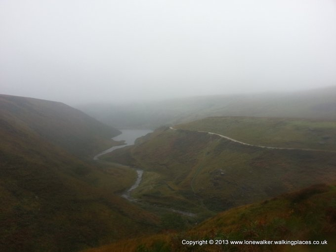 Looking back to Blakely Reservoir through the rain and mist
