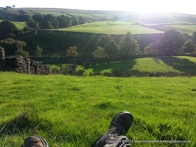 Feet up, catching the sun, on the ascent out of Ponden