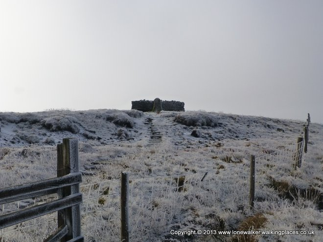 A wintery summit shelter on Great Shunner Fell