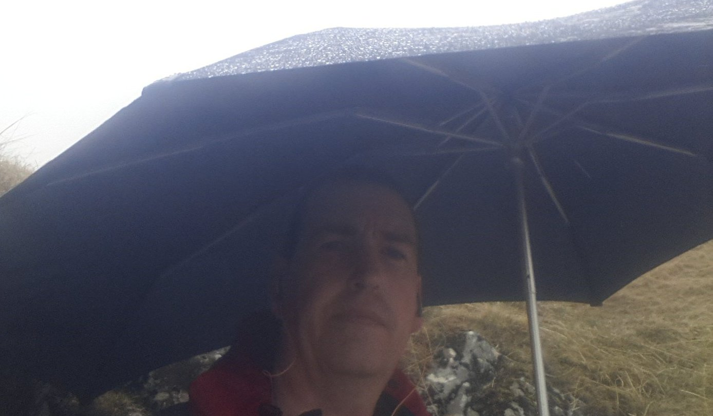 Sheltering under the umbrella for a quick break in the rain