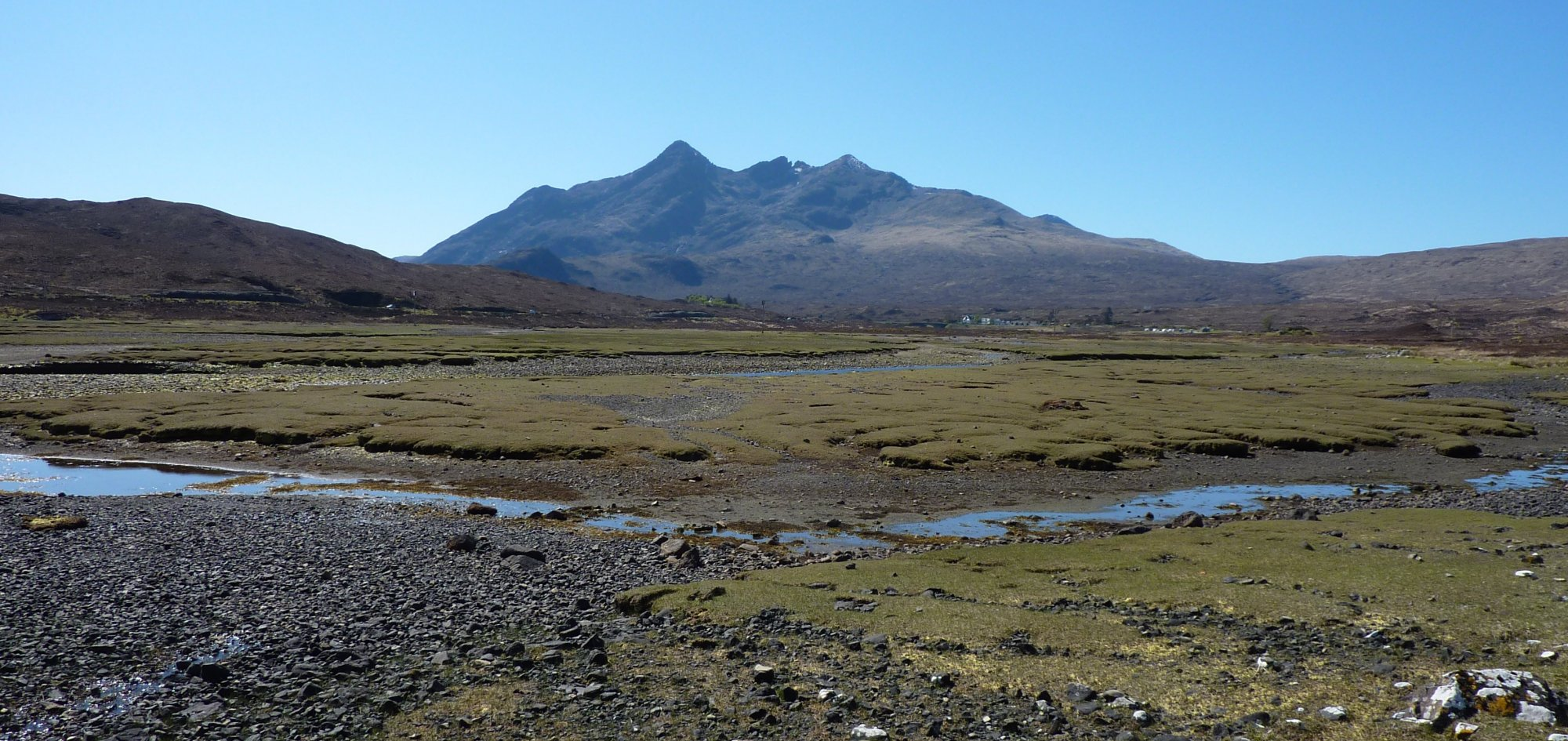 Crossing the salt marshes at the head of the Loch, with Cuillins in the background