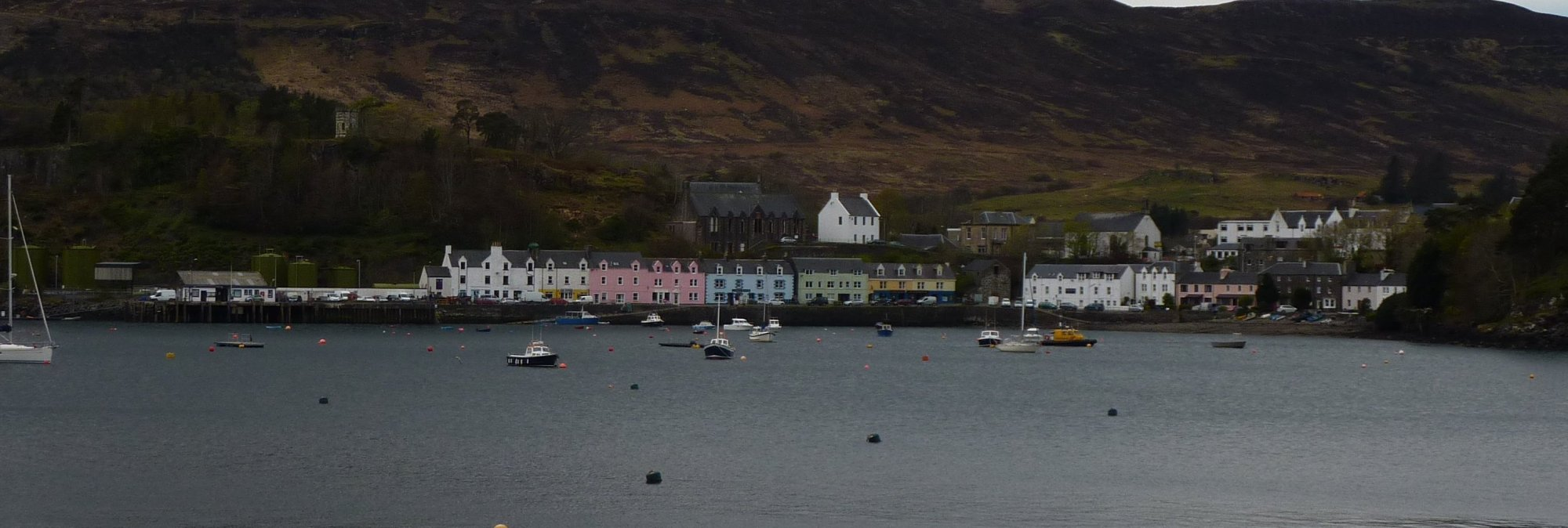 The distinctive, colourful houses of Portree across the bay