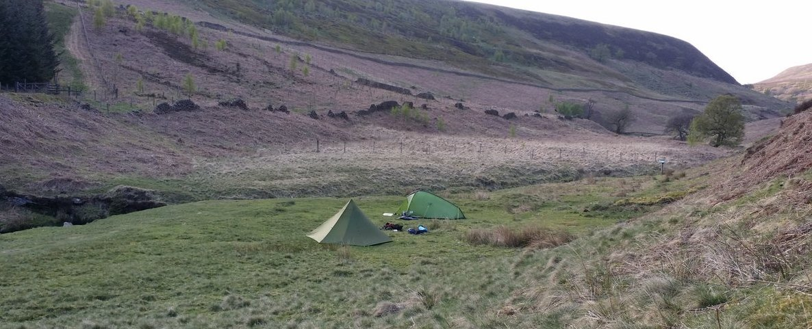 Flat, green pitch beside River Derwent