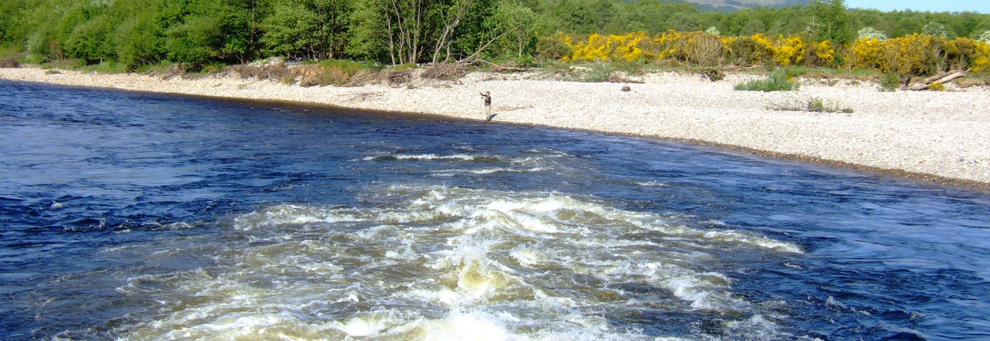 White water from the tailrace enters the River Lochy
