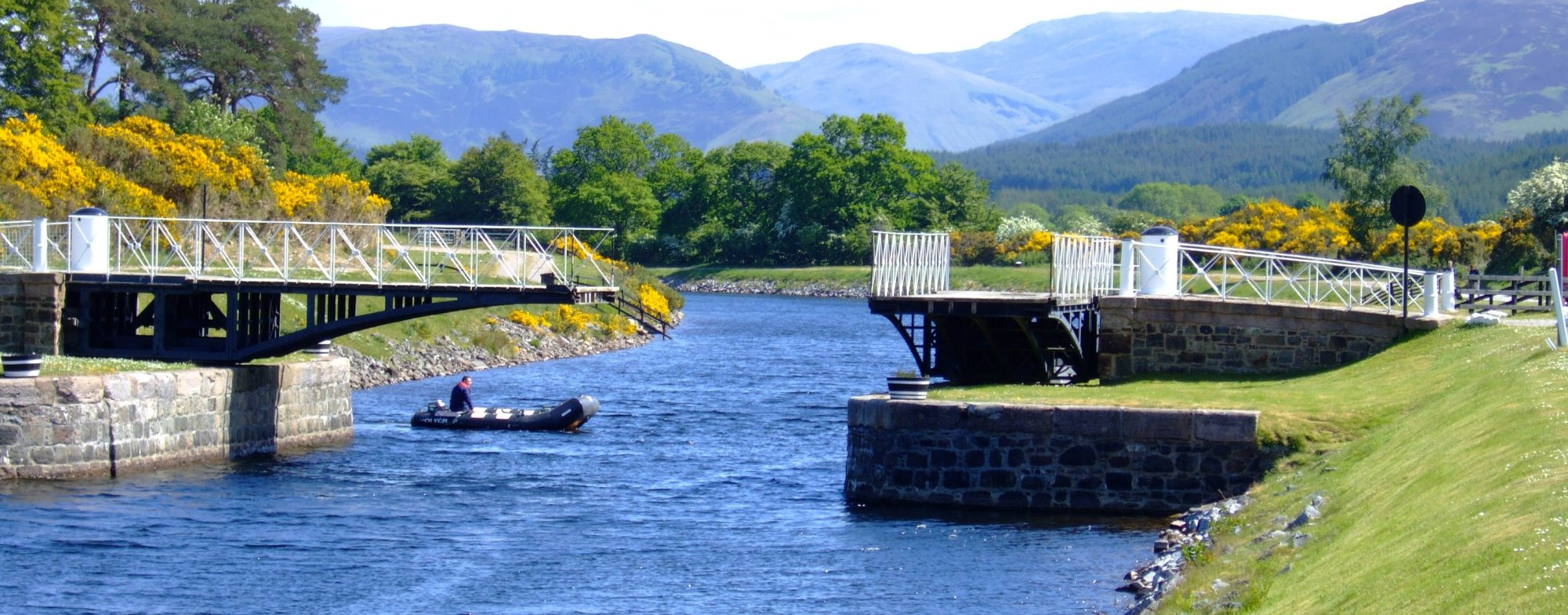 The bridge keeper at Moy Bridge, closes the span after letting a boat pass through