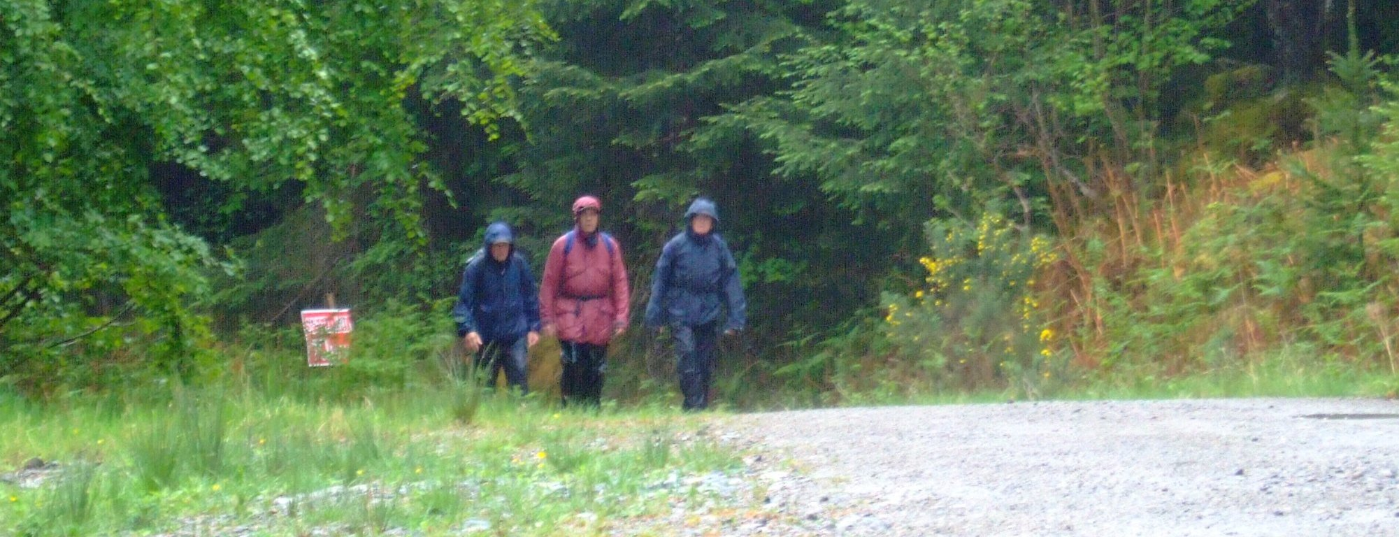 Looking a wee bit wet, three of the guys approaching the crest of a long pull