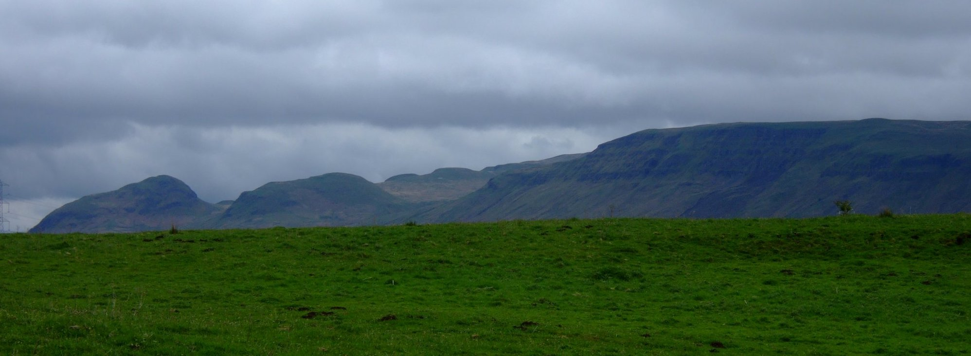 Dumgoyne and Dumfoyn and the long craggy face of Black Craig, seen from Mugdock Country Park