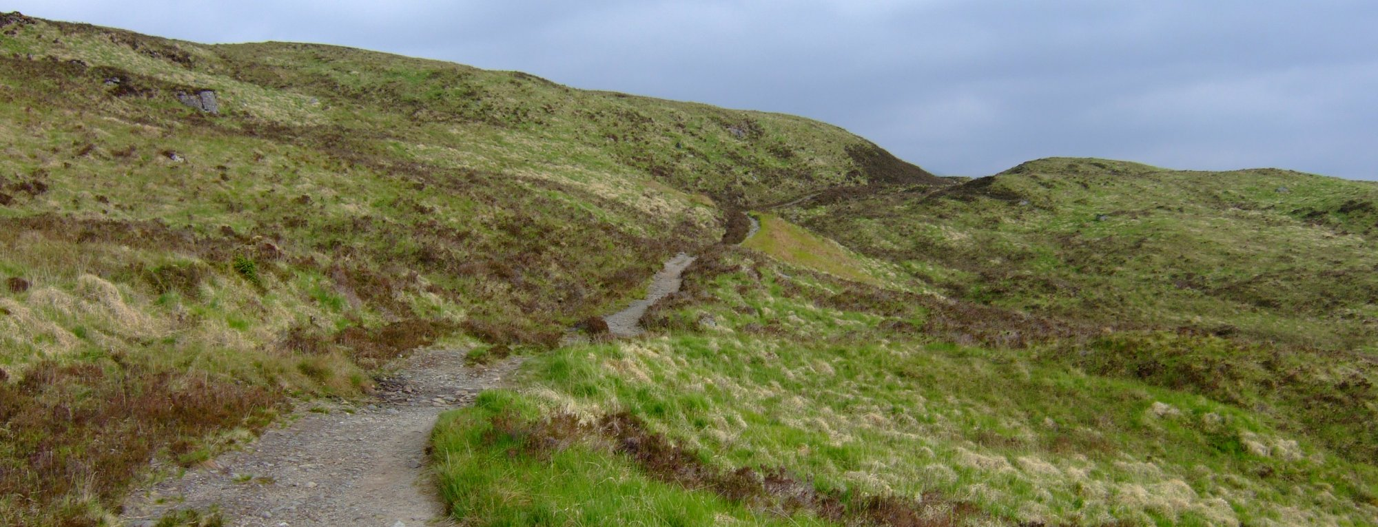 Following the old military road over Mam Carraigh