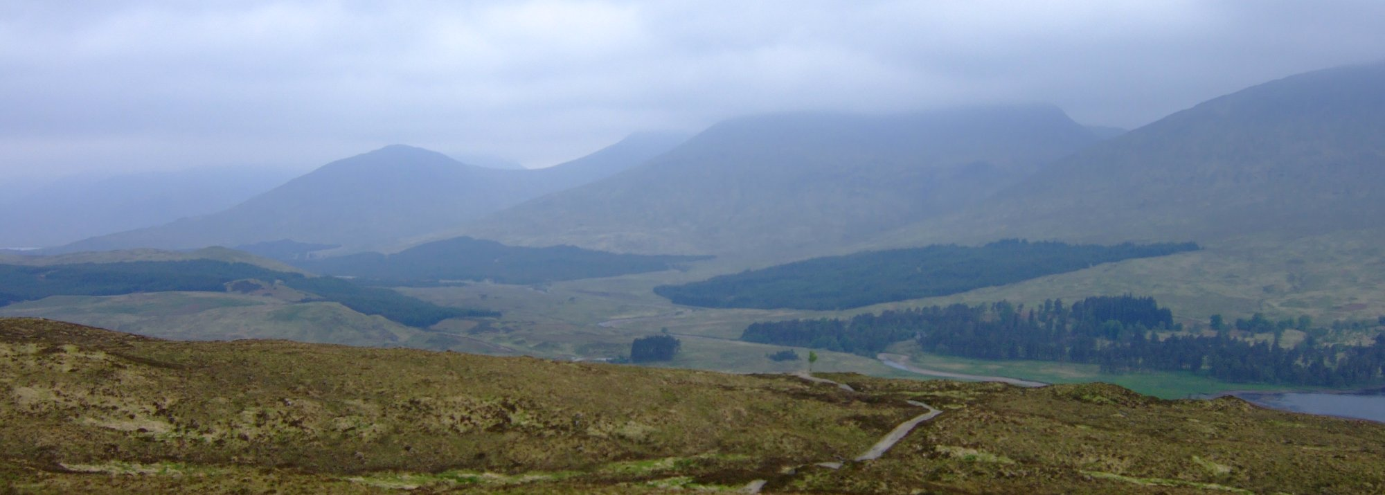 Looking down towards the Inveroran Hotel, Stob Ghabar with its head in the cloud