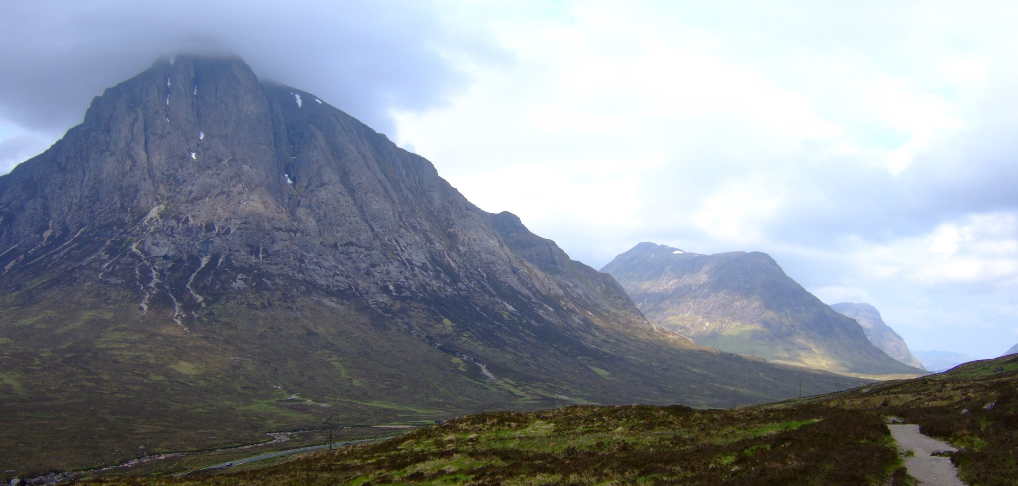 Buachaille Etive Mor with Buachaille Etive Beag beyond and the first of the Three Sisters, Beinn Fhada, in the distance