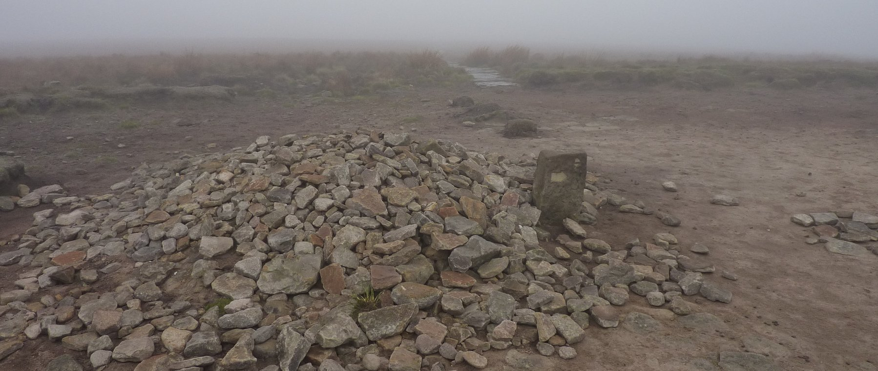 Large cairn marks the junction at Mill Hill