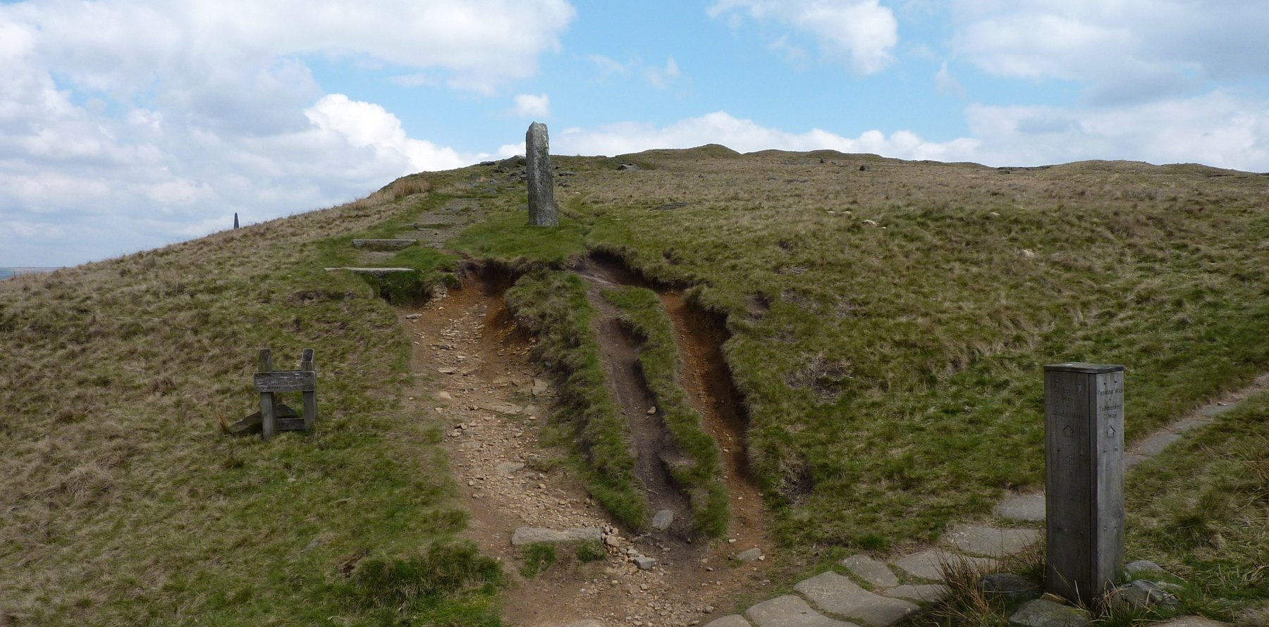 Crooked stone and unusual box signpost on the way to Stoodley Pike