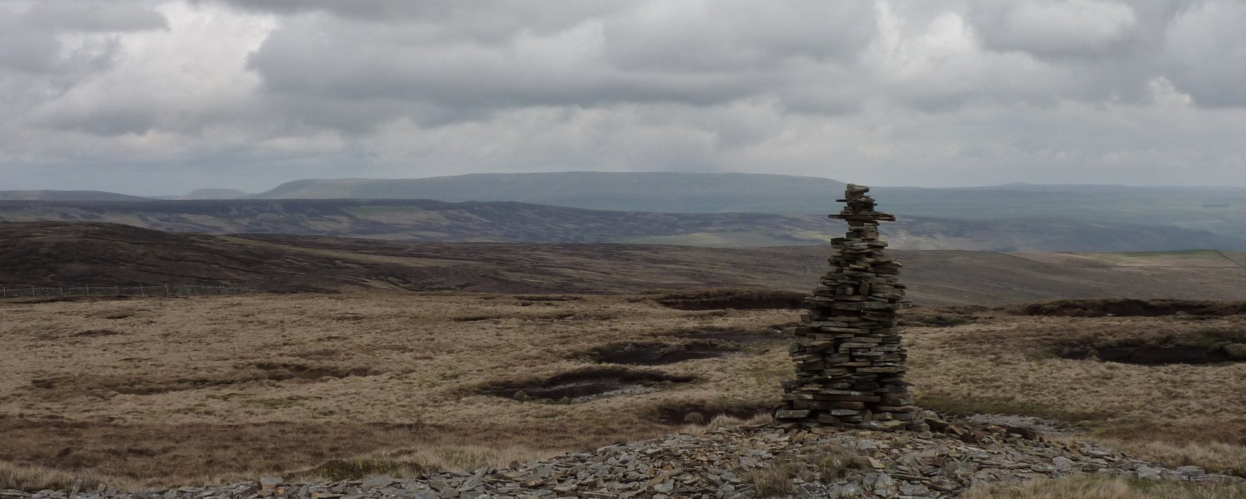 Cairn on the highpoint of the path over Fountains Fell