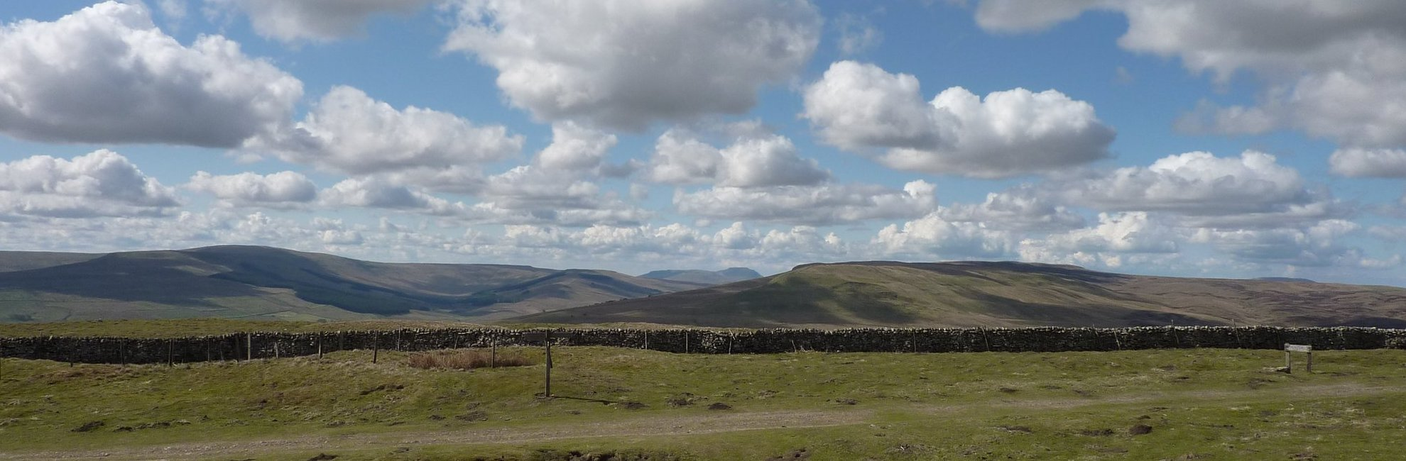 Looking across to Ingleborough from the path up Great Shunner Fell