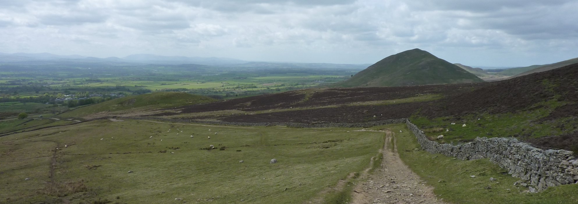 The long road into Dufton - with Dufton Pike watching every step