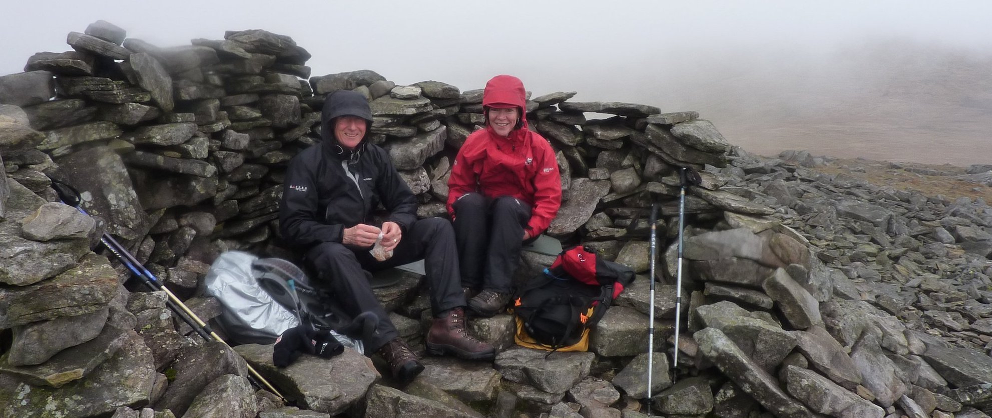 Steve and Jane, huddled in the shelter on Little Dunn Fell