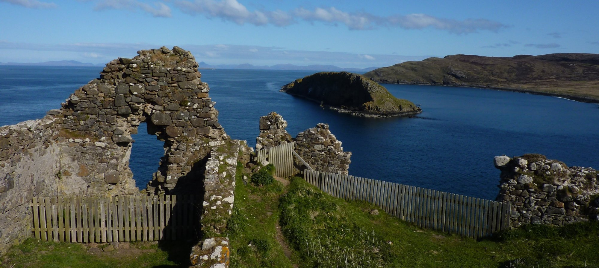 Looking across the broken remains of Duntulm Castle towards Harris and Lewis