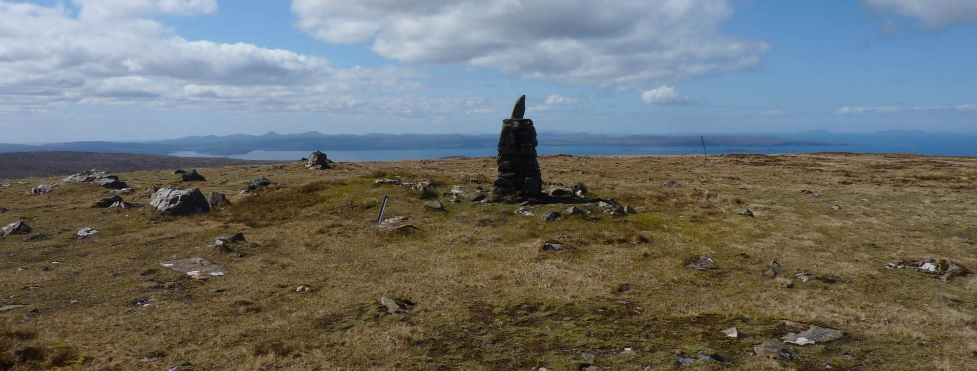 Approaching the Quiraing trig point on Meall na Suiramach