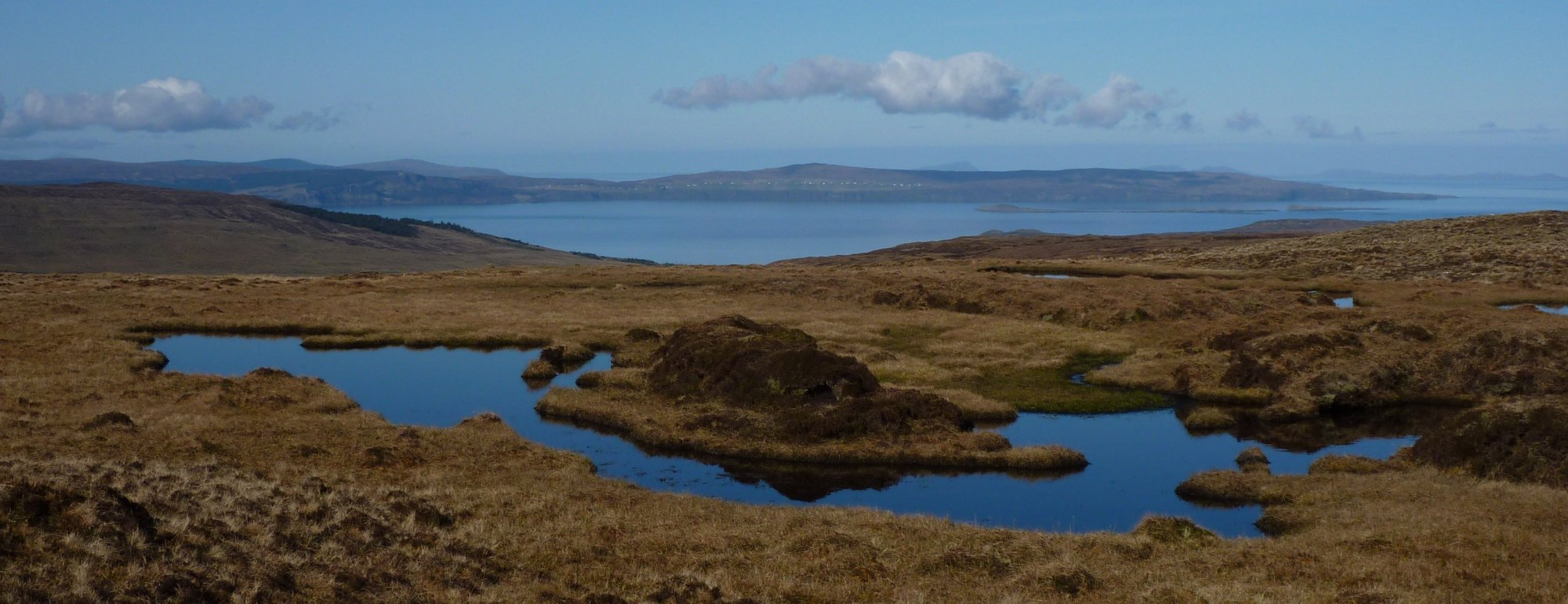 Across the tiny lochan on Beinn Edra towards the Waternish peninsula