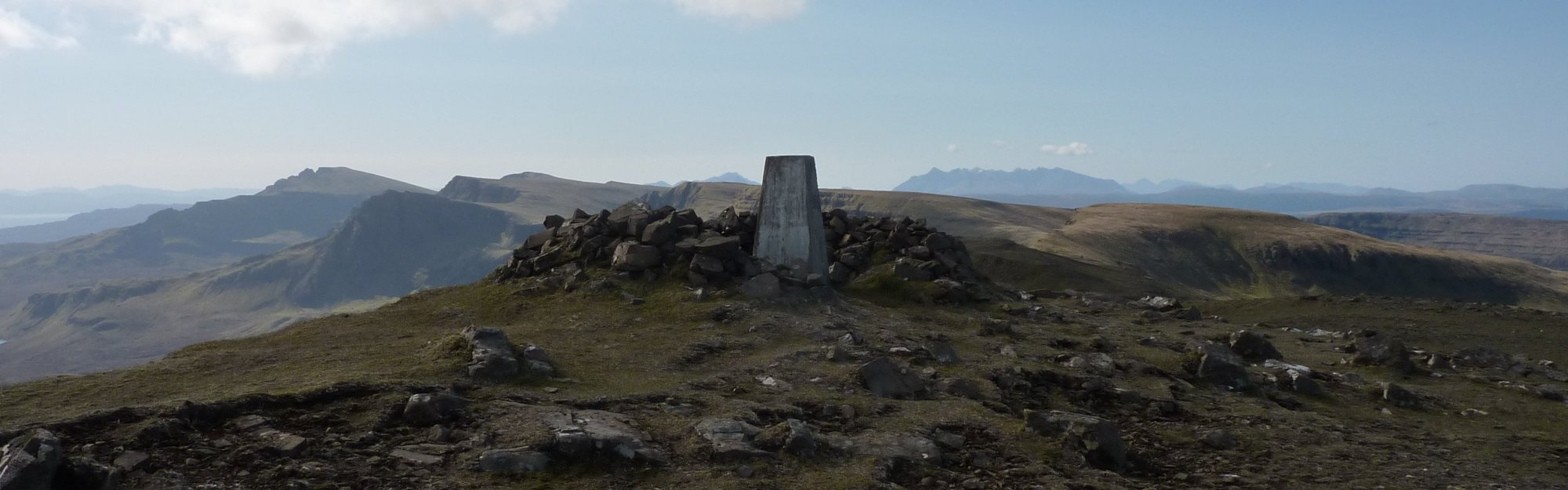 Trig point and shelter on summit of Beinn Edra, with the Storr far left behind