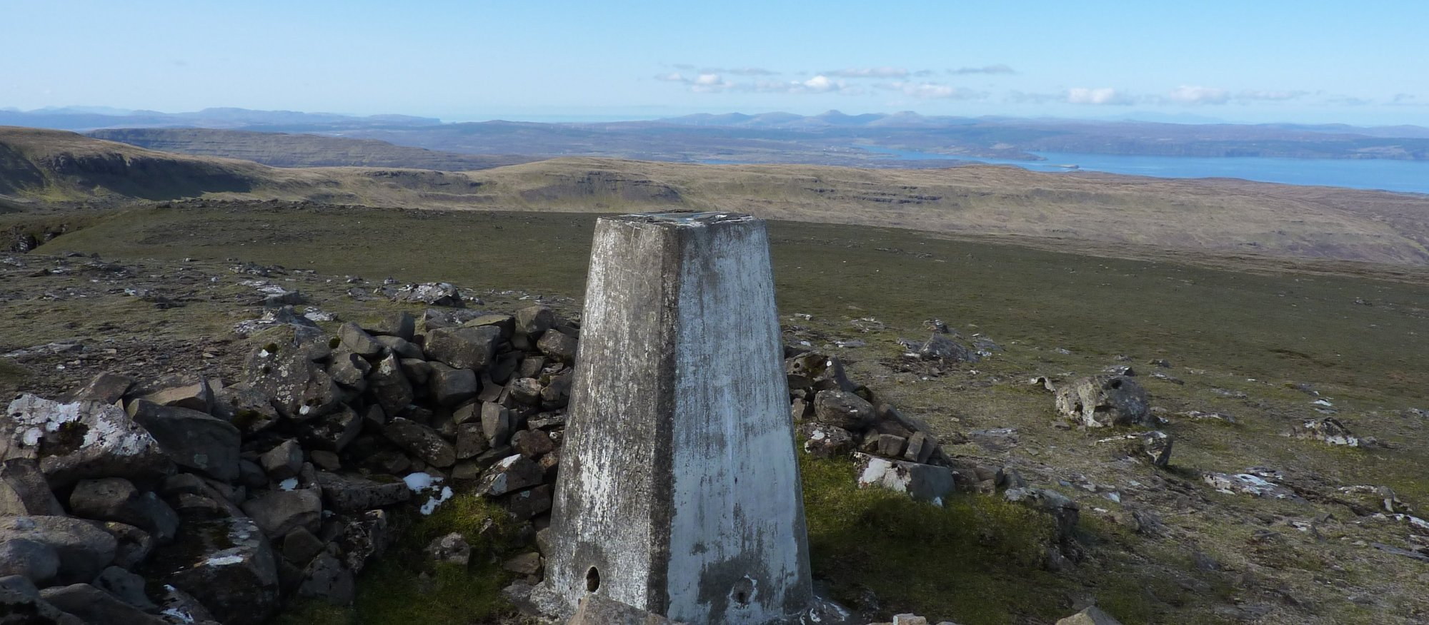 Beyond the trig point is the Duirinish peninsula and the two distinctive summits of Macleod's Tables