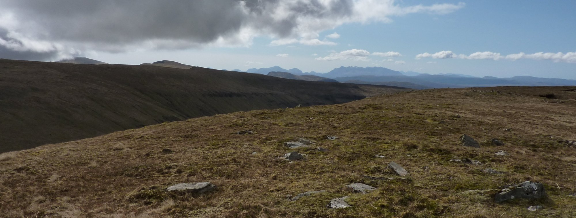 The rock-strewn summit of Creag a'Lain, with the Cuillins far left