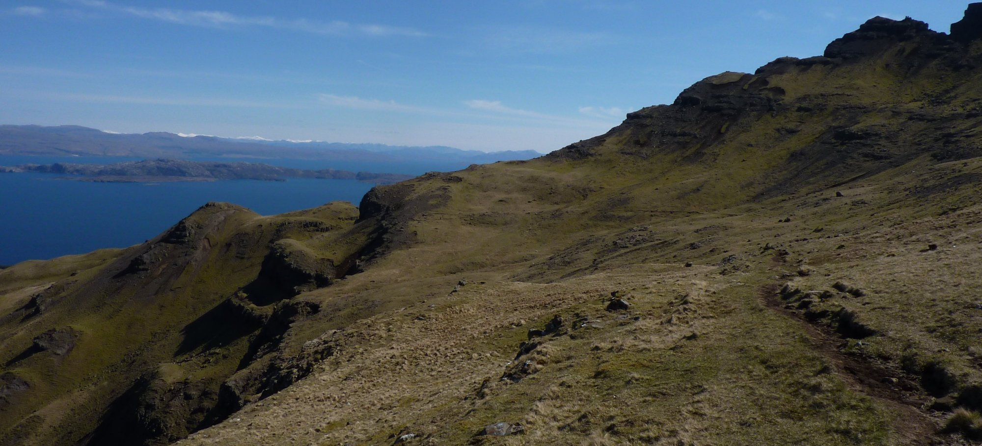 Along the excellent path beneath the Storr - the white-capped hills are over 40 miles away (Carn Eige)