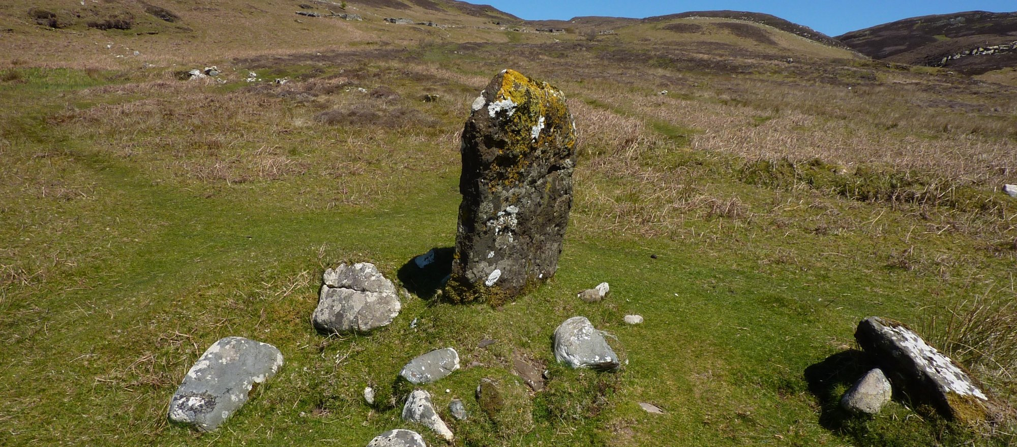 The standing stone in the centre of the community, my path leads away up to the skyline ahead
