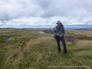 Matt on the summit of Bleaklow with the huge cairn behind