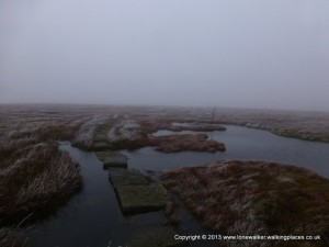 Crossing the slabs on the approach to Great Dunn Fell