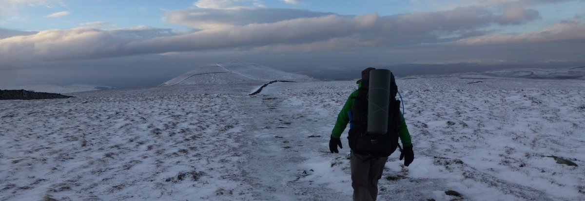 Heading for Pen-y-Ghent, across the frozen peat hagg